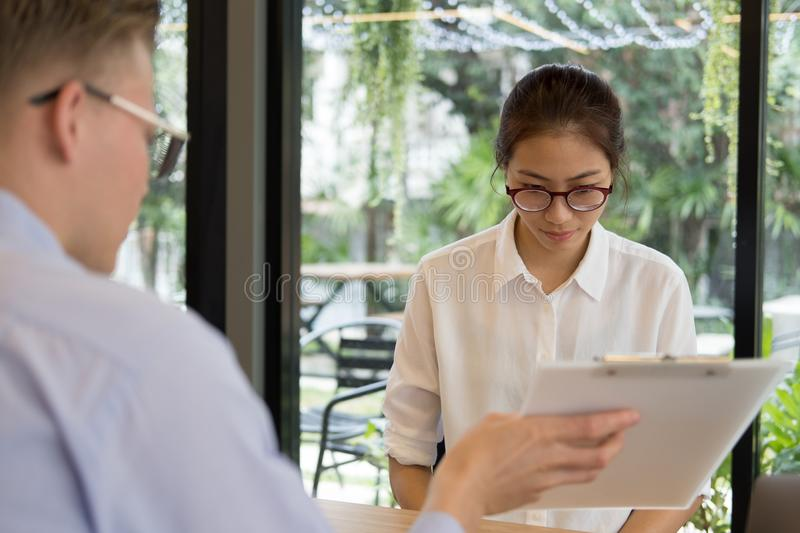 Furious boss scolding frustrated woman at office. irritated man. Furious boss scolding frustrated women at office. irritated men blames upset intern for failure stock photos