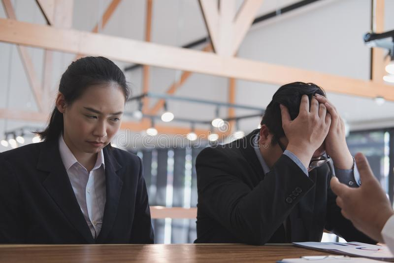 Furious boss scolding frustrated woman at office. irritated man. Furious boss scolding frustrated women at office. irritated men blames upset intern for failure royalty free stock photo