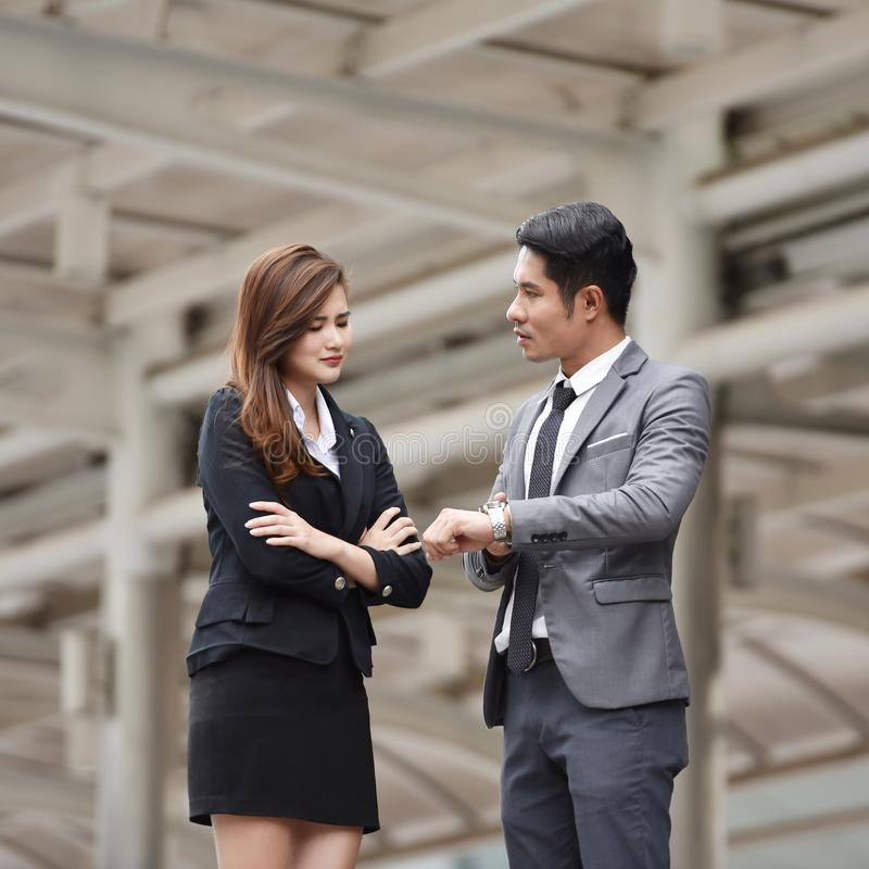Furious boss scolding young Business woman. stock image