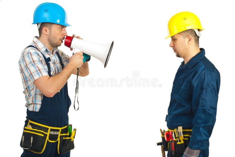 Furious boss shouting megaphone to employee