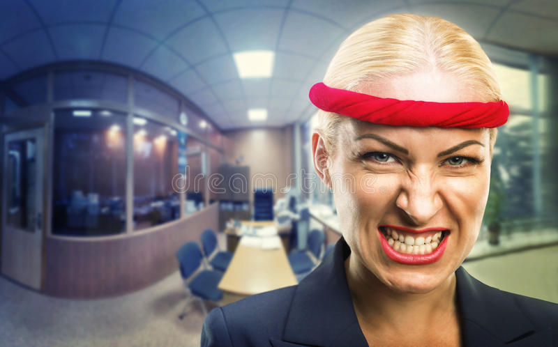 Furious business lady. Furious businesswoman with a red bandage in the office stock photos