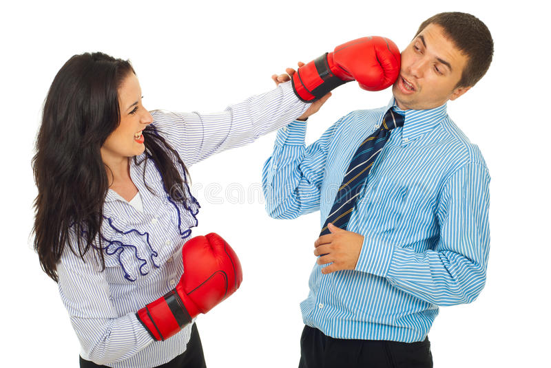 Furious business woman kicking man royalty free stock photo