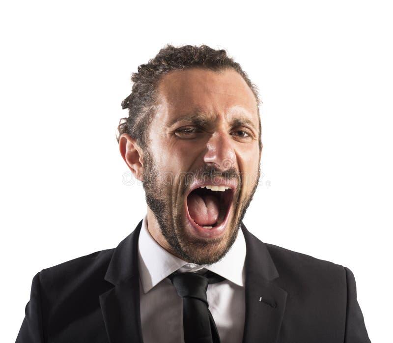 Furious businessman screaming. Portrait of an angry furious businessman screaming stock photos