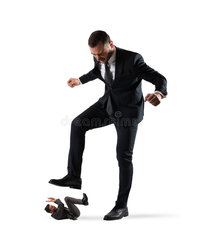 Furious businessman who want to trample his employee. In office stock image