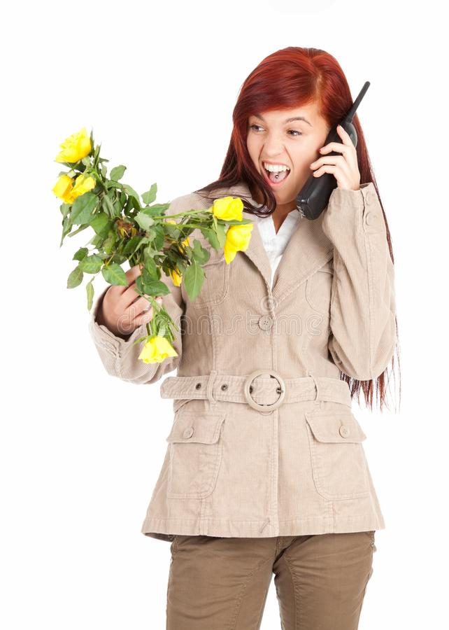 Download Furious Calling Young Woman With Flowers Stock Image - Image: 23806489