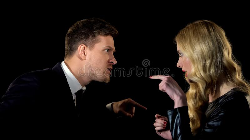 Furious couple arguing, blaming each other, relationship crisis black background royalty free stock photos