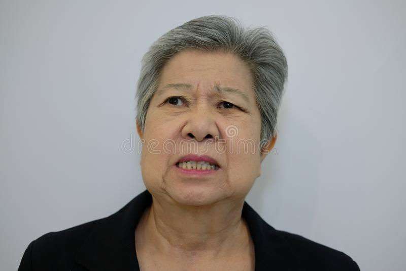 Furious elder woman, enraged elderly female. angry senior. Furious elder woman, enraged elderly female. angry asian senior royalty free stock photography