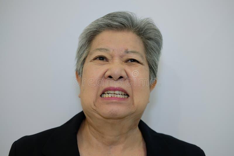 Furious elder woman, enraged elderly female. angry senior. Furious elder woman, enraged elderly female. angry asian senior royalty free stock images