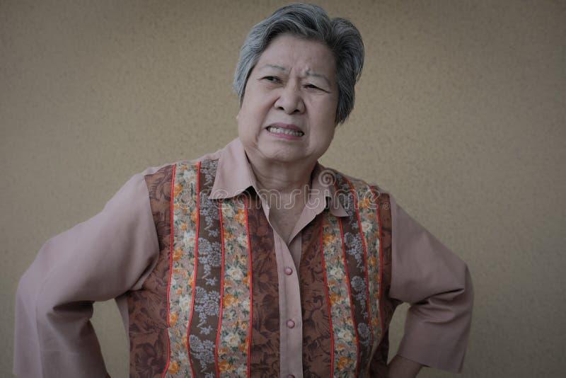 Furious elder woman. enraged elderly female. angry asian senior. Portrait of furious elder woman. enraged elderly female. angry asian senior royalty free stock photography