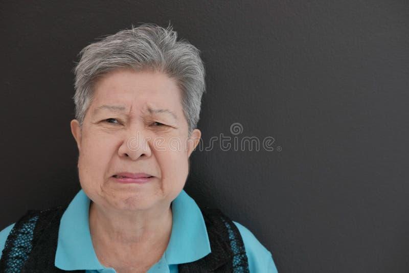 Furious elder woman, enraged elderly female. angry senior. Furious elder woman, enraged elderly female. angry asian senior royalty free stock photo