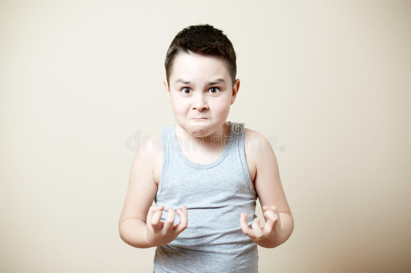 Furious kid. With emotion on face stock images