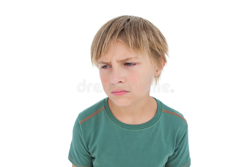 Furious little boy looking down royalty free stock photography