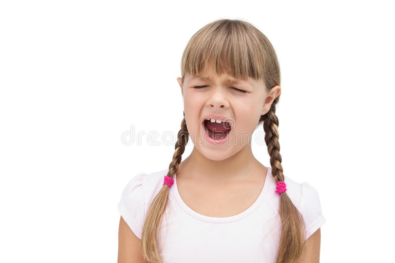 Furious little girl with eyes closed. On white background stock image