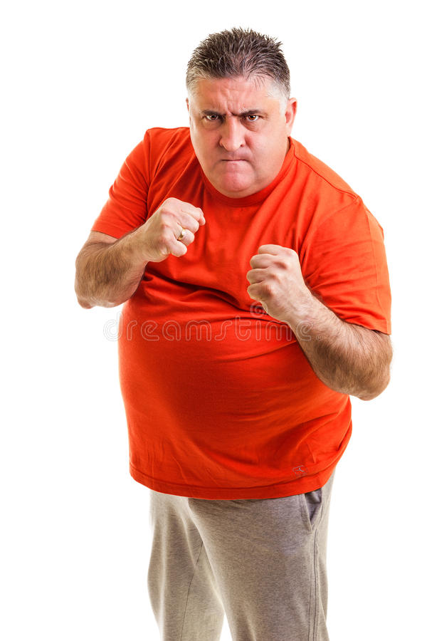 Furious man clenching his fists ready to fight royalty free stock photography