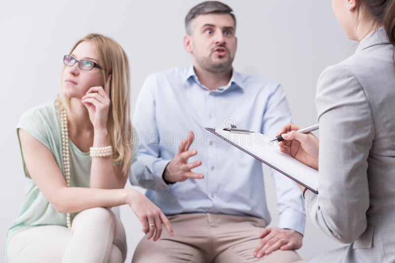 Furious man during couples therapy stock photos