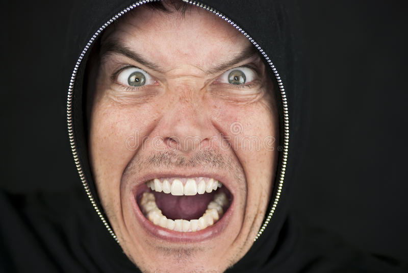 Furious Man Looks To Camera. Close-up of an furious man looking to camera stock image