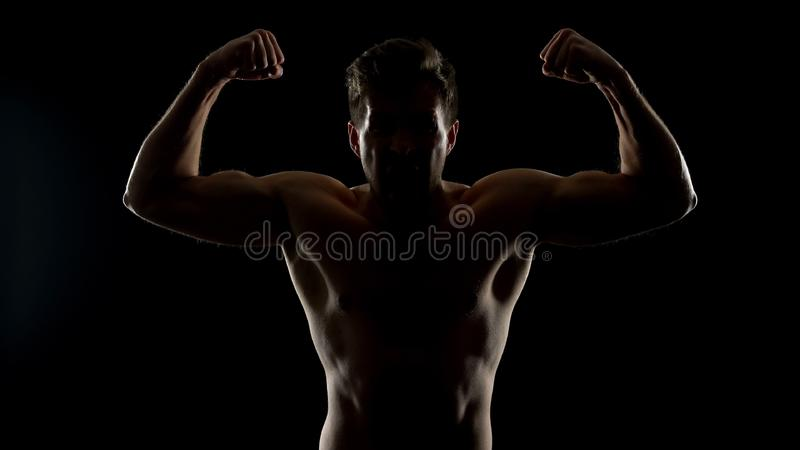 Furious man showing biceps muscles, demonstrating power, ready for illegal fight stock photography