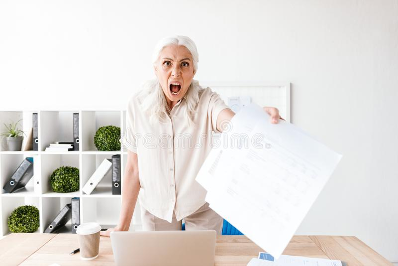Furious mature business woman royalty free stock photo