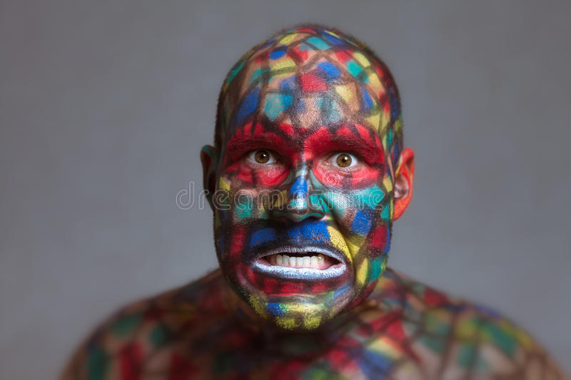 Furious villain colorful face looking at you royalty free stock photos
