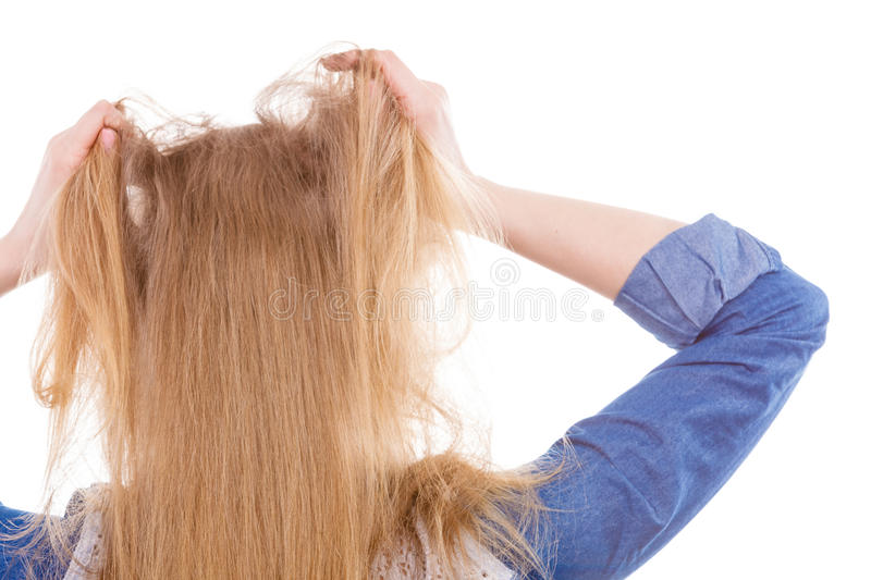 Furious woman pull hair out of head. Fury and big anger inside of people. Blonde furious woman pulling blonde hair out of head. Emotional young girl showing her royalty free stock photos