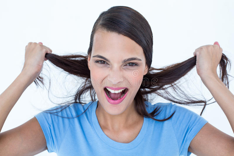 Furious woman pulling her hair. On background royalty free stock images