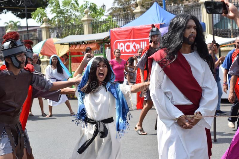 Furious Woman run attacking Jesus Christ, street drama, community celebrates Good Friday representing the events that led to the C. San Pablo City, Laguna stock photo