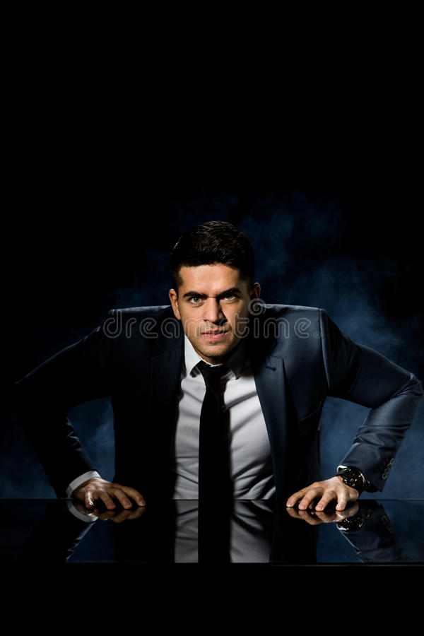 Furious young boss. In suit in his office stock photography