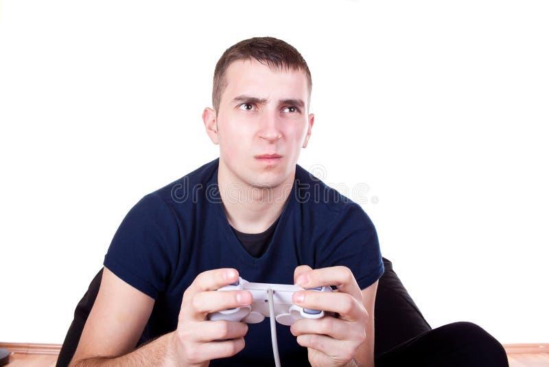 Furious young man with a joystick stock images