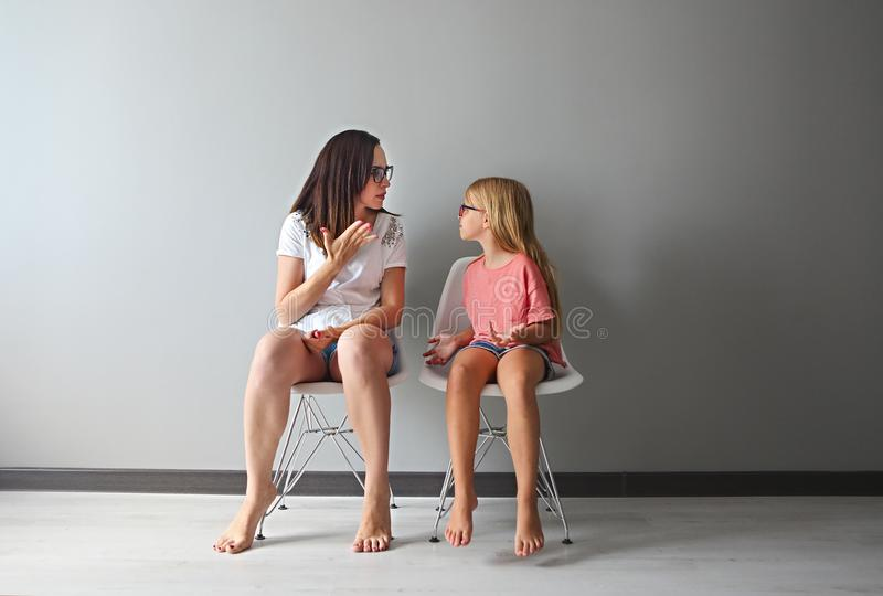 Furious young mother in a discussion with her little daughter royalty free stock photos