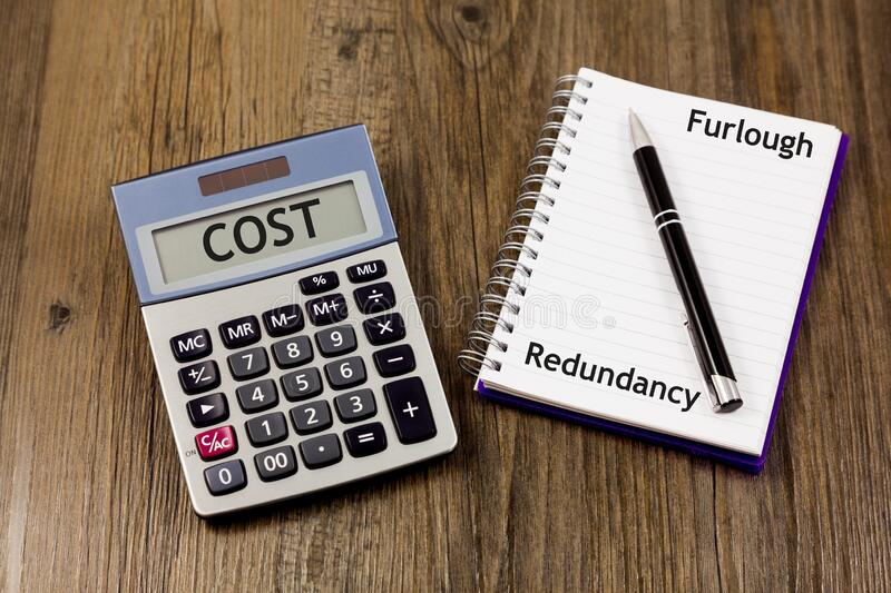 Furlough and Redundancy Concept - with calculator, notepad and pen. Furlough and Redundancy Concept - with calculator and the word `cost royalty free stock images