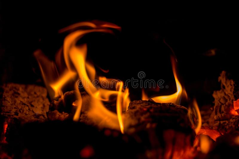 In the furnace a bright fire burns, it`s nice to sit by the hearth stock image