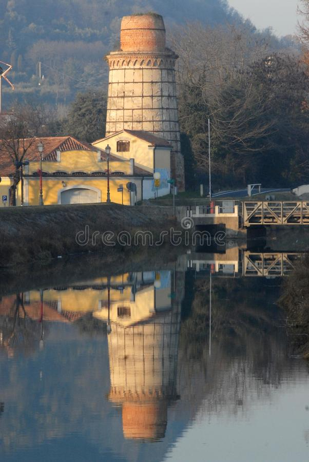 Furnace to produce lime and its reflection. Photo made in Monselice province of Padova (Italy). Monselice is a country that is located on the hills Hills stock images