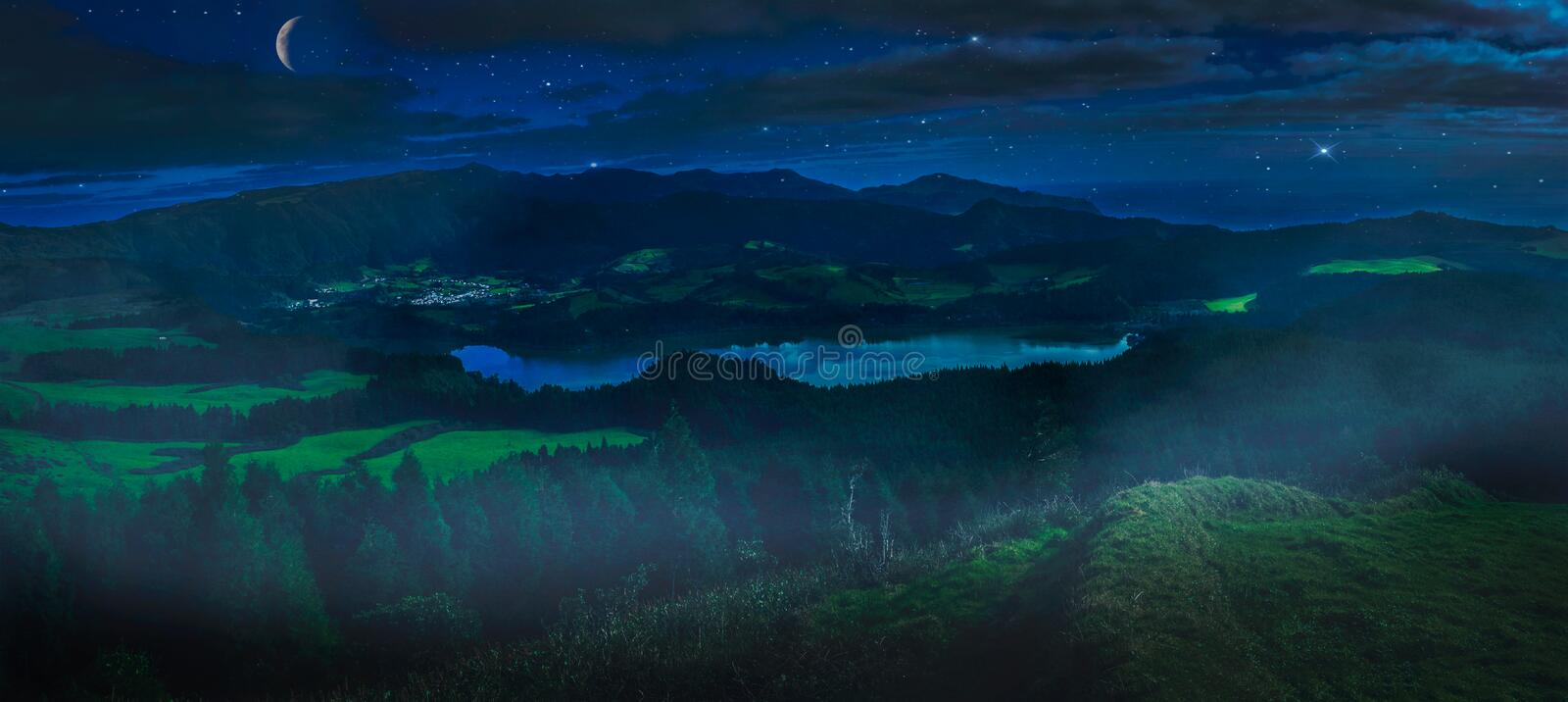 Furnas Lake at night. Nighttime picture of the stunningly beautiful volcanic crater Furnas Lake, Sao Miguel, Azores, Portugal royalty free stock photos