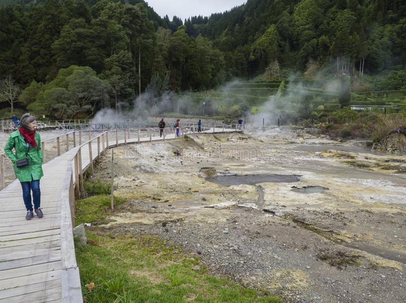 Furnas, Sao Miguel, Azores island, Portugal, December 22, 2018: Tourists watching the steam from Hot springs and royalty free stock photos