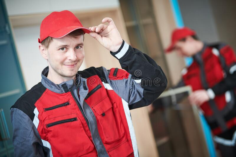 Furniture assembling. Professional worker portrait in front of installing cabinet at living room. Furniture assembling. Professional contractor carpenter royalty free stock photos