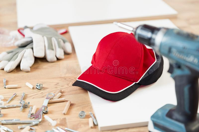 Furniture assembly parts and tools for self assembly furniture, on the floor royalty free stock photography
