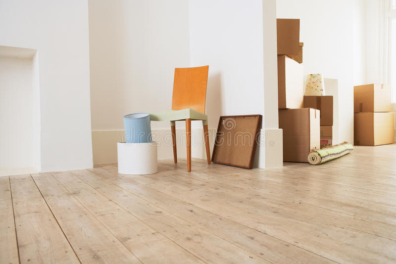 Furniture And Boxes In New House stock photos