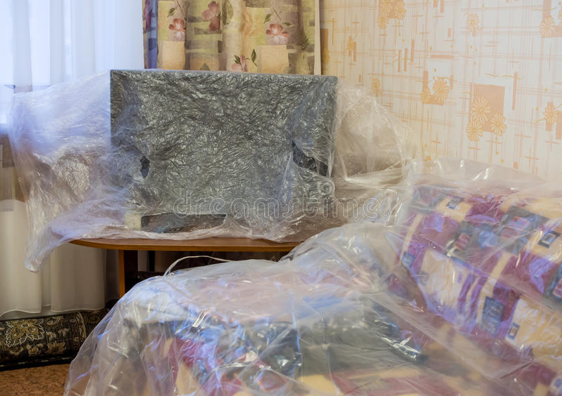 download furniture covered with plastic film on the repair time editorial stock photo image