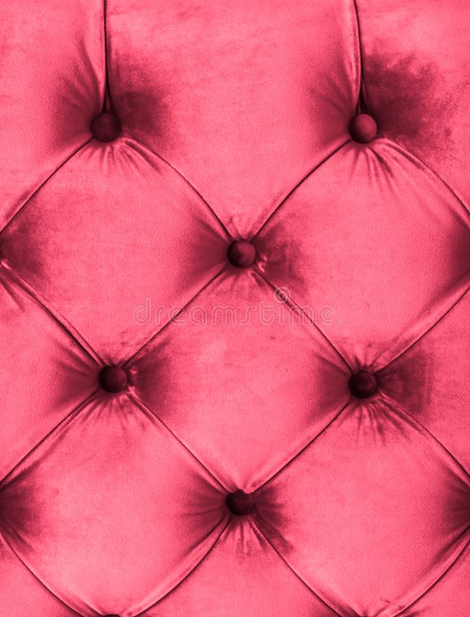 Pink luxury velour quilted sofa upholstery with buttons, elegant home decor texture and background royalty free stock images