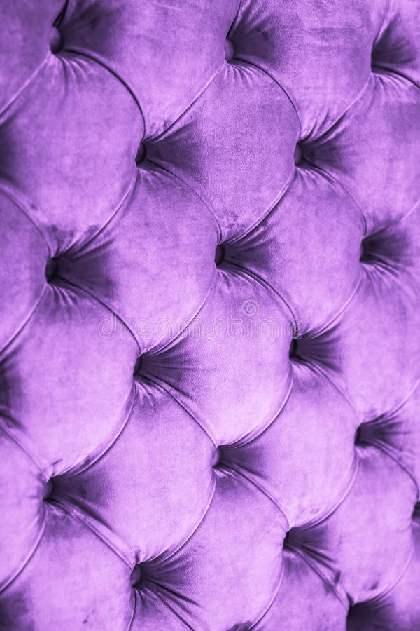 Purple luxury velour quilted sofa upholstery with buttons, elegant home decor texture and background. Furniture design, classic interior and royal vintage stock photography