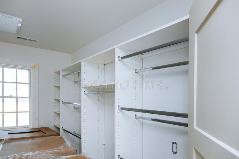 Furniture installation of shelves with a shelf new construction of interior room stock photo