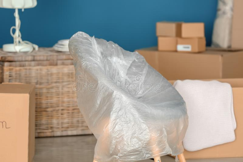 Furniture with moving boxes at new home stock images