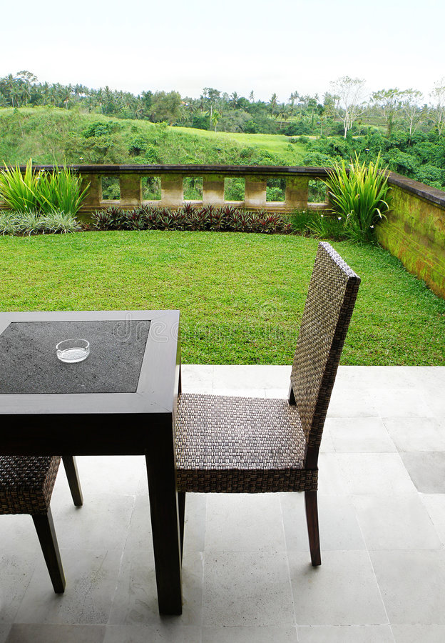 Free Furniture On Landscaped Patio With View Royalty Free Stock Image - 8064636