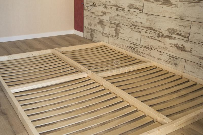Wooden planks on the bottom of double floor bed royalty free stock photography