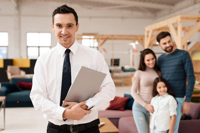 Furniture retailer in the store looking at the camera. stock photos