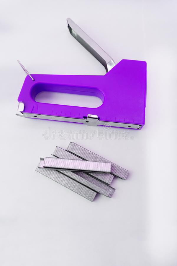 Furniture stapler chrome craft device fasteners firm fix.  stock photos