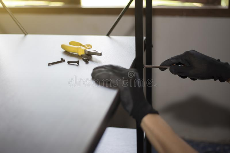 Furniture technician is working to assemble furniture stock photos