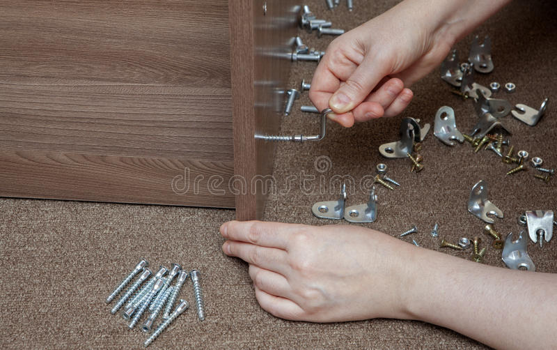 Furniture wooden assembly frame manually tightening using stock photo