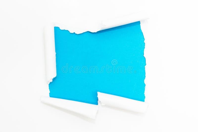Furo azul no Livro Branco Espa?o vazio para o texto fotografia de stock