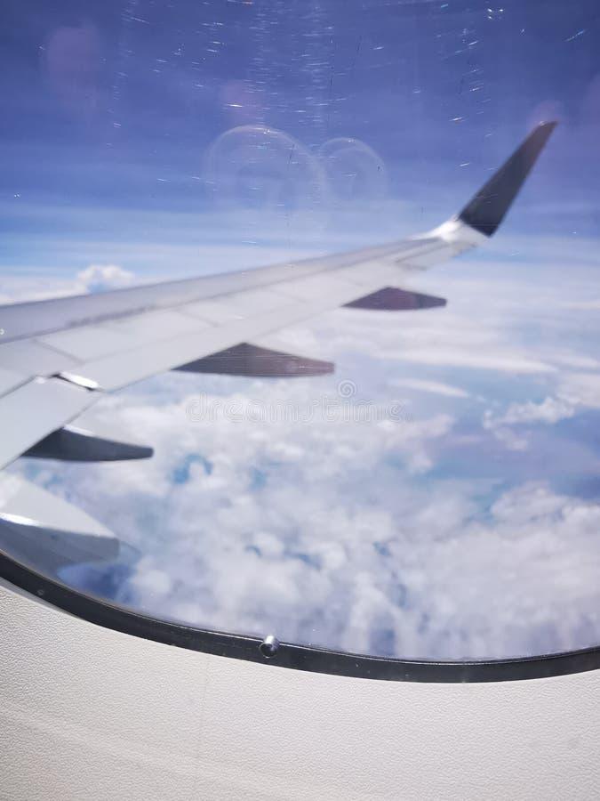 Furo de equação de pressão da janela do avião fotografia de stock